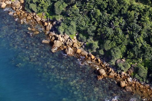 Aerial view of turquoise sea water and rocky coastline. Summer vacation concept. Vietnam, Phu Quoc