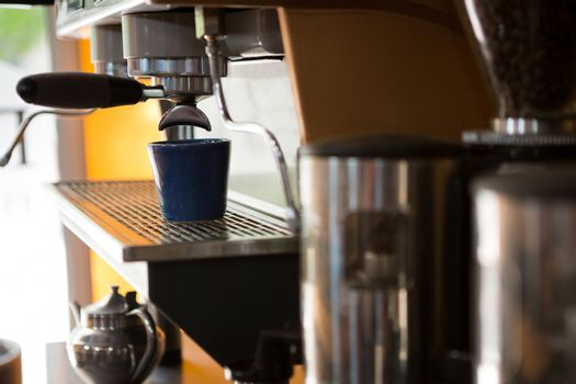 Machine making cup of coffee