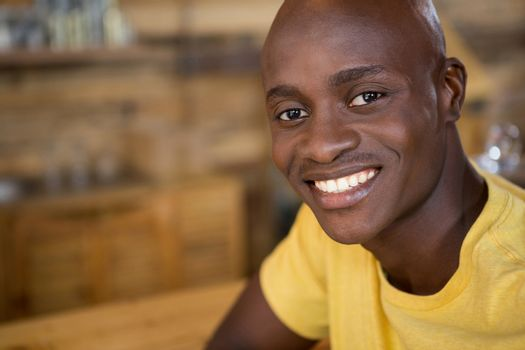 Portrait of young man smiling in coffee house