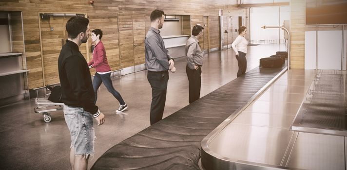 People standing by baggage claim