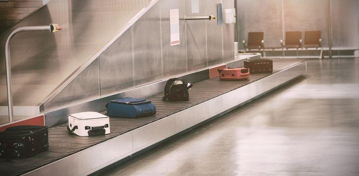 Luggage passing through baggage claim
