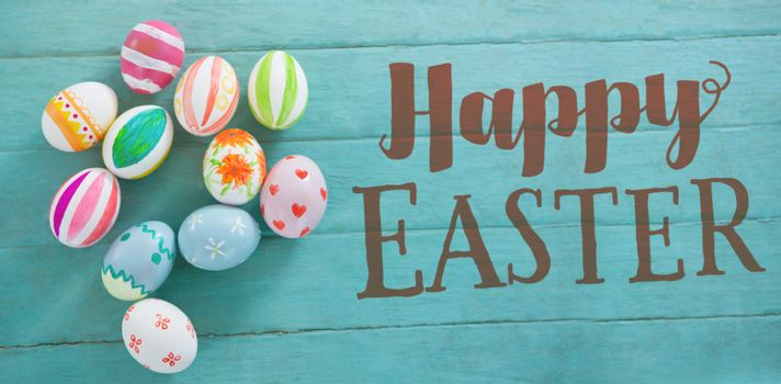 Easter greeting against painted easter eggs on wooden table
