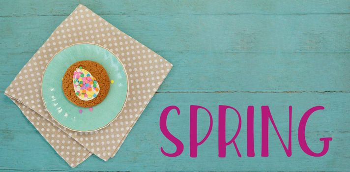 Easter greeting against cookie with various confectioneries in plate