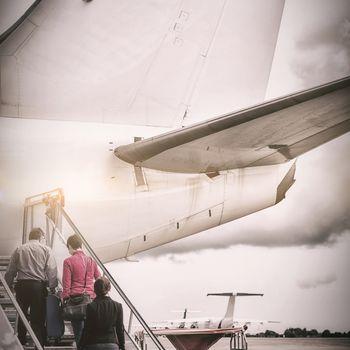 People boarding in airplane
