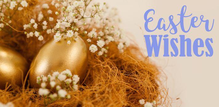 Easter greeting against golden easter eggs in nest