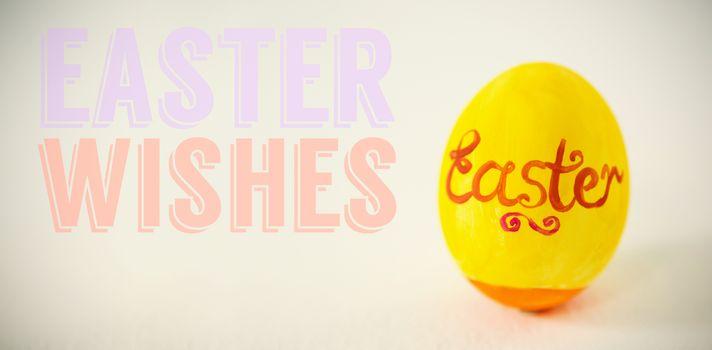 Easter greeting against easter text written on egg