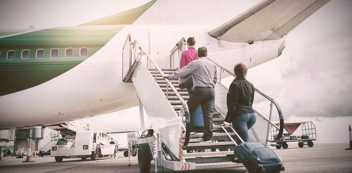 People on airstairs at runway