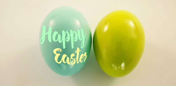 Happy easter logo against blue and green easter eggs on white background