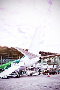 Airplane parked at runway