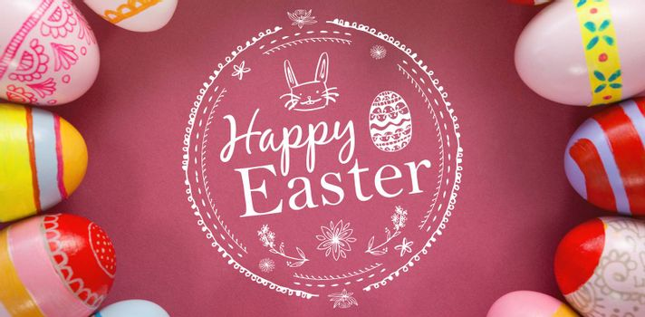 Happy easter logo against various easter eggs arranged on pink background