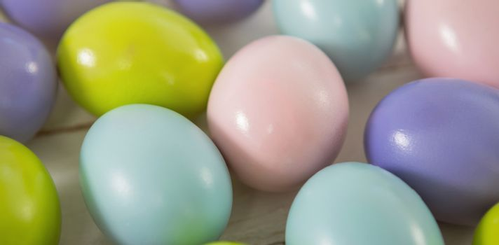 Close-up of multicolored Easter eggs on wooden surface