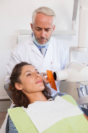 Dentist taking an xray of patients mouth at the dental clinic
