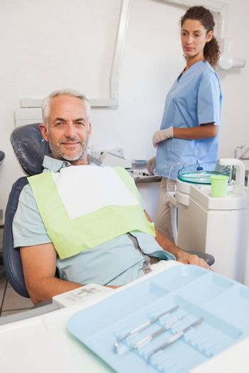 Patient smiling at camera sitting in the chair at the dental clinic