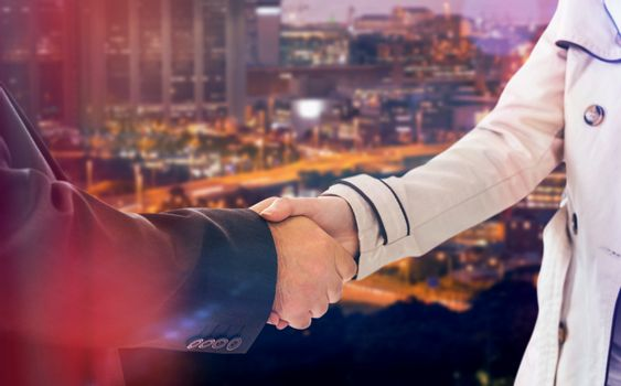 Composite image of ale and female corporate people shaking hands