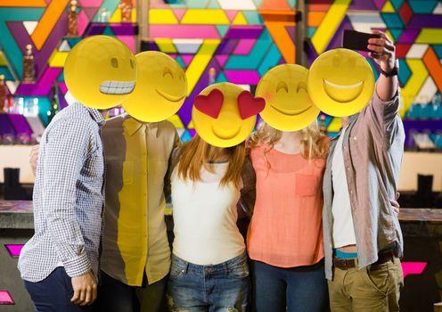 selfie in the party. Emoji heads.