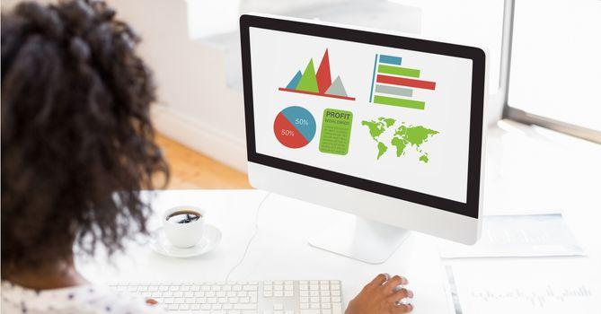 Businesswoman making graphs on computer