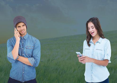 People on phones in field