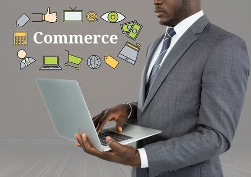 Man with laptop and Commerce text with drawings graphics