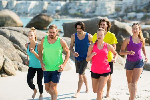 Friends jogging on shore