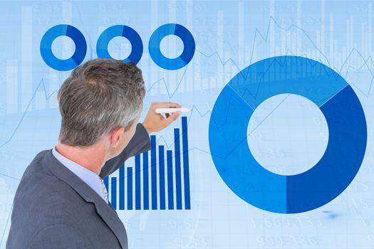 Businessman making graphs on screen