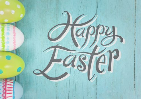 Grey easter graphic against teal table with eggs