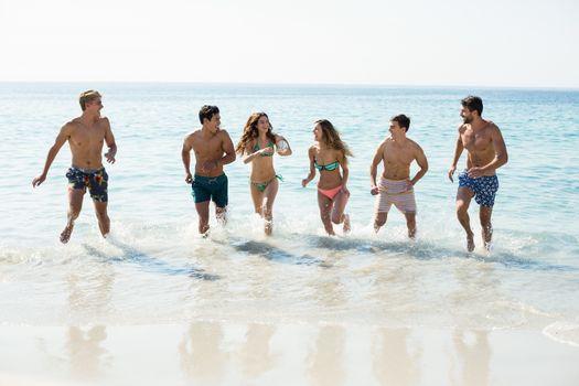 Friends running on shore