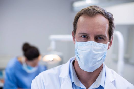 Portrait of dentist wearing surgical mask in dental clinic