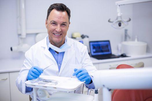 Portrait of smiling dentist in dental clinic