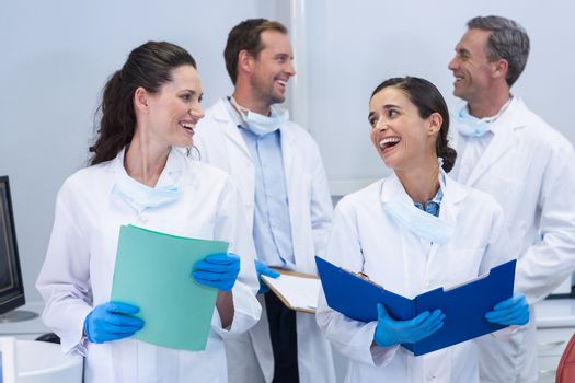 Dentists interacting with each other