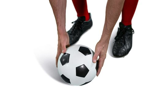 Football player placing football