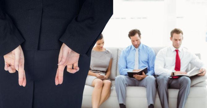 Woman with his fingers crossed arriving to a interview in a company