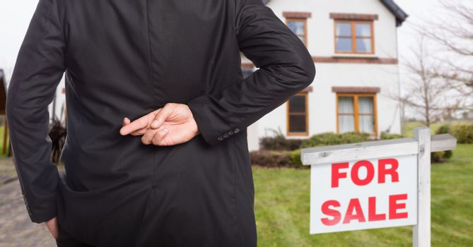 property seller with his fingers crossed