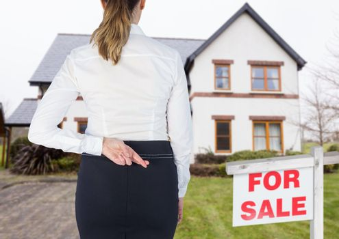 Property seller woman with her fingers crossed