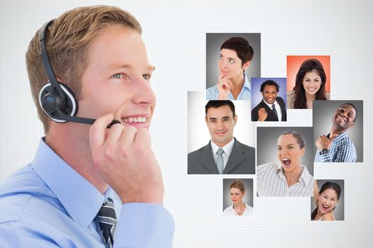 Digital composite image of businessman using headphones by candidates against white background