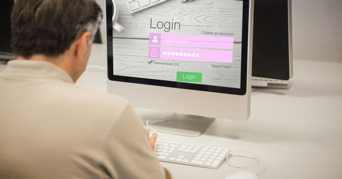 Rear view of businessman logging in on site using computer