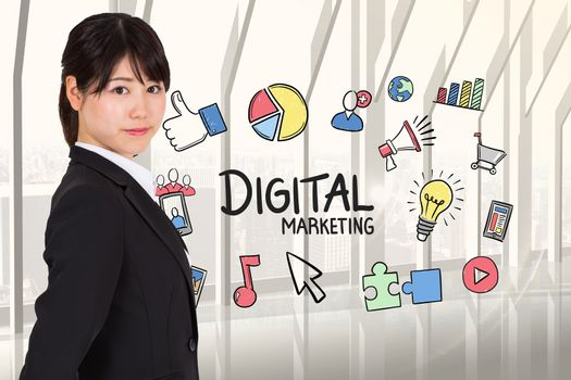 Side view of businesswoman with digital marketing graphics