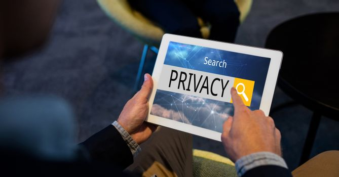 Hand searching privacy word on tablet PC