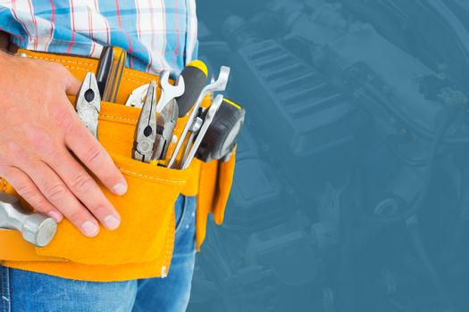 Midsection of handyman with tools