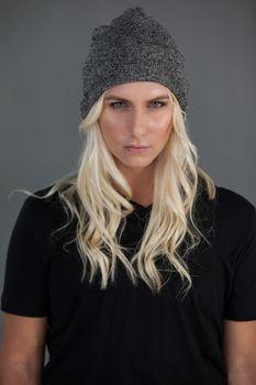 Portrait of beautiful transgender woman wearing knit hat