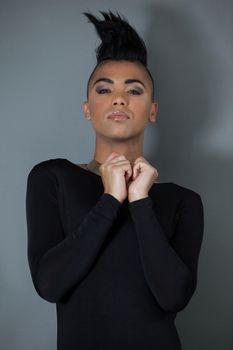 Portrait of confident transgender with half shaved