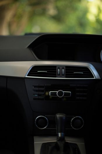 Dashboard and gearshift in car