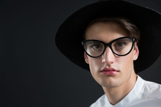 Androgynous man in spectacles