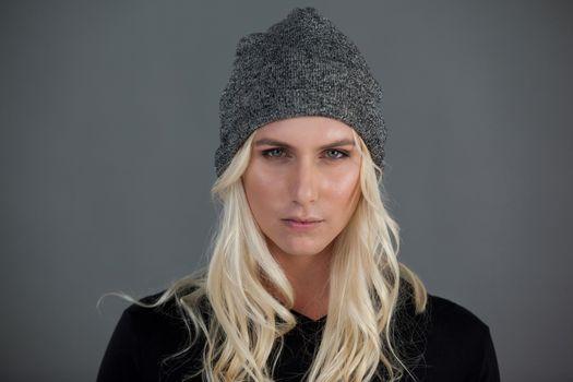 Portrait of transgender woman wearing knit