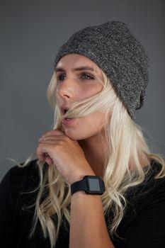 Transgender woman wearing knit hat