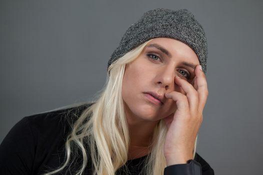 Portrait of transgender woman wearing knit hat