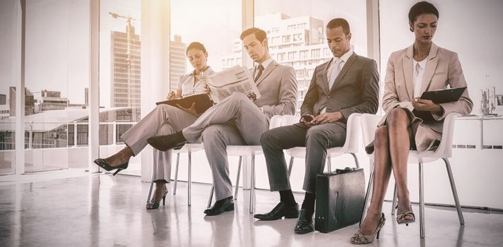 Well dressed business people sitting together