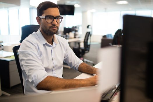 Concentrated businessman working in office