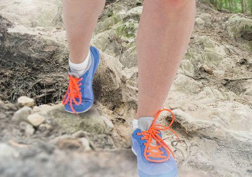 Legs Walking or jogging on rough nature terrain