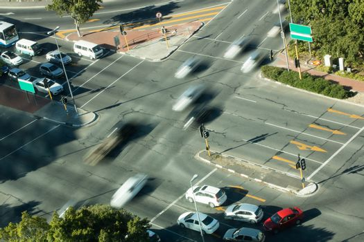Blurred motion of cars on road intersection