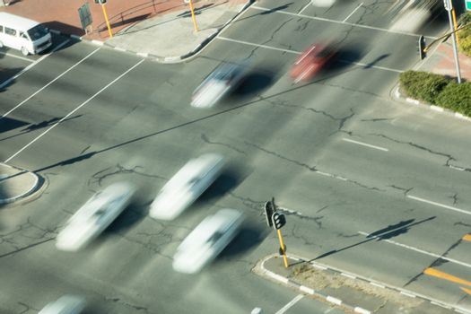 High angle view of blurred cars on road intersection